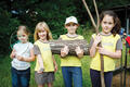 Brownies collect wood for a campfire