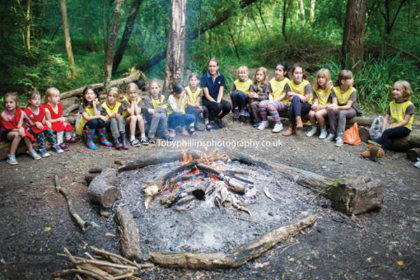 Brownies and rainbows around a campfire