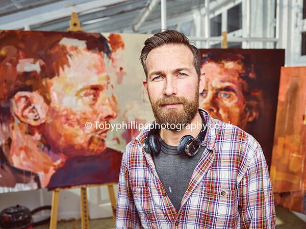 Jeremy Bridle with his portraits
