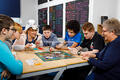 Pupils play Monopoly at Muntham House School